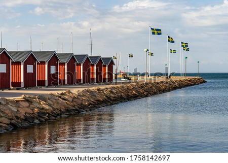 Typical Swedish west coastal environment with red boathouses, bridges and happy summer guests enjoying the perfect weather. #1758142697