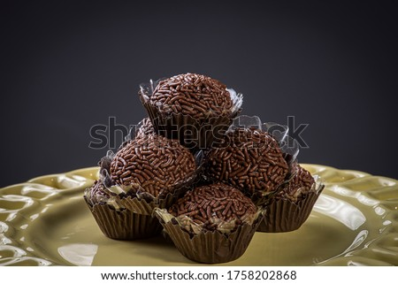 Brigadeiro. Typical Brazilian sweet. Some brigadiers together in a dark background Royalty-Free Stock Photo #1758202868