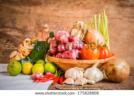 Still life of mix vegetable arranged with basket and white fabrics place on old wooden #175828808