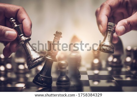 Businessman moving chess piece on chess board game concept for ideas and competition and strategy, business success concept, business competition planing teamwork strategic concept. #1758384329