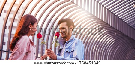 Focus of lovers That give roses Bright smiley face Feeling of love each other, banner image size