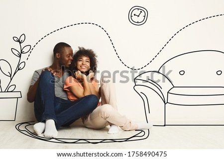 Black guy and his girlfriend imagining their new furnished home against white wall with interior drawings Royalty-Free Stock Photo #1758490475