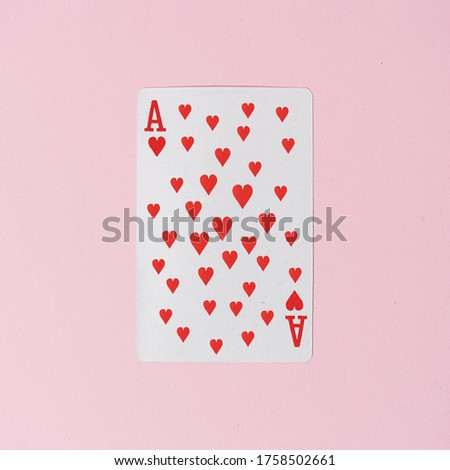 Ace of hearts playing card with many hearts in middle. Creative minimal love concept background.