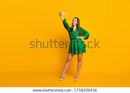 Full length body size view of her she nice attractive lovely pretty luxury cheerful straight-haired girl taking making selfie isolated over bright vivid shine vibrant yellow color background