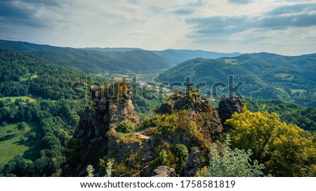 Beautiful view to valley with river Labe in czech central mountain from hill Vrabinec, Czech republic. Green mixed forests in pictoresque valley in czech central mountain #1758581819