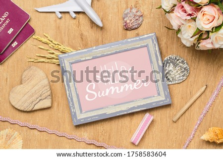 Mockup Photo Frame Travel Summer Holiday Background Concept. Flat lay top view mock up picture frame, passport, sea shells, flower, plane model. #1758583604