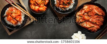 Korean food, Cabbage kimchi and Radish kimchi with rice top view set on dark background. Royalty-Free Stock Photo #1758601106