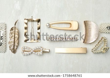 Beautiful different hair clips on white table, flat lay Royalty-Free Stock Photo #1758648761