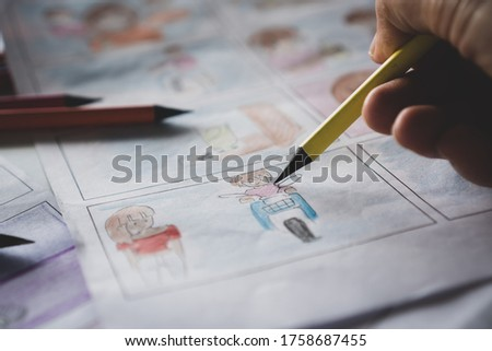 designer or creative drawing storyboard for film movie, Video Pre-production process media films in form displayed script production. design shot and scene layout. Media product in studio concept
