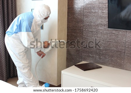 a technician is sanitizing an hotel room in Prague, using steam and ozone,  after the coronavirus SARS-CoV-2 COVID-19 pandemic Royalty-Free Stock Photo #1758692420