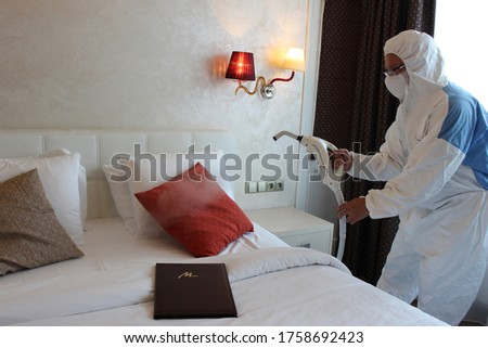 a technician is sanitizing an hotel room in Prague, using steam and ozone,  after the coronavirus SARS-CoV-2 COVID-19 pandemic Royalty-Free Stock Photo #1758692423