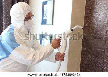 a technician is sanitizing an hotel room in Prague, using steam and ozone,  after the coronavirus SARS-CoV-2 COVID-19 pandemic Royalty-Free Stock Photo #1758692426