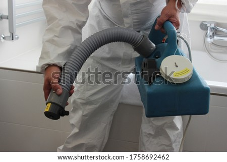 a technician is sanitizing an hotel room in Prague, using steam and ozone,  after the coronavirus SARS-CoV-2 COVID-19 pandemic Royalty-Free Stock Photo #1758692462