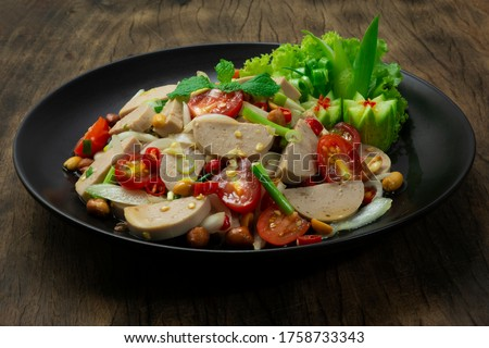 Spicy Vietnamese Pork Sausage Salad with Vegetables GoodTasty Appetizer Healthyfood or diet The Most Popular Thai &Vietnamese Food Fusion Style decorate Vegetables and cucumber sideview Royalty-Free Stock Photo #1758733343
