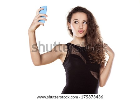 pretty teen girl taking selfies with her smart phone