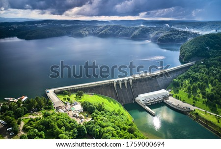 The Solina Dam aerial view, largest dam in Poland located on lake Solinskie. Hydroelectric power plant in Solina of Lesko County in the Bieszczady Mountains area of south-eastern Poland. Royalty-Free Stock Photo #1759000694