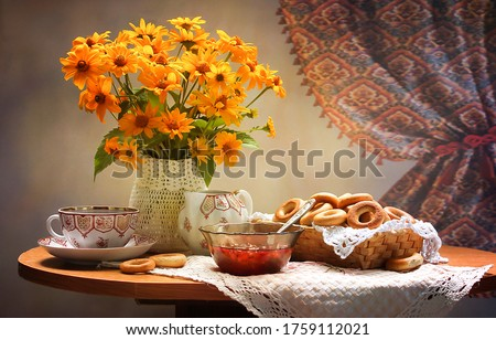 Tea table with vase of flowers. Tea time with flowers. Tea table vase flowers. Tea table and vase of orange flowers #1759112021