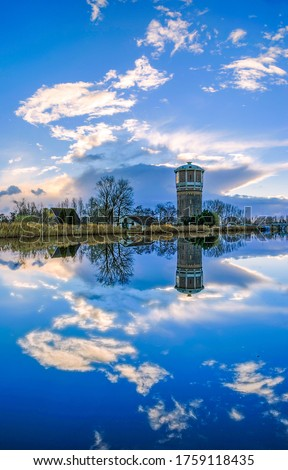 Sunset lake island tower reflection in water. Lake tower reflection in water #1759118435