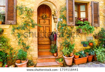 Old Italy street house entrance. Arched door in Italy town #1759118441