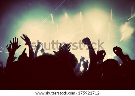 People with hands up having fun on a music concert, disco party. Vintage, retro style #175921712