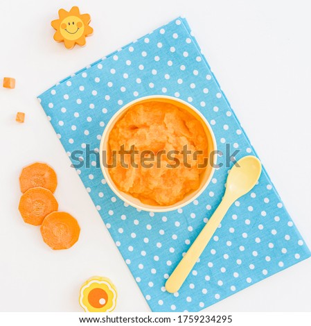 Bowl with carrot puree for baby Royalty-Free Stock Photo #1759234295
