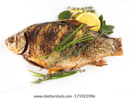 Fried fish crucian Isolated on white background #175923986