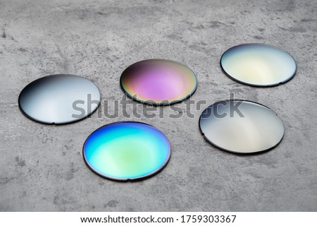 Close up of optical lenses for sunglasses with different color. Production and adjust of new eyeglasses lens in optics. Eyesight concept Royalty-Free Stock Photo #1759303367
