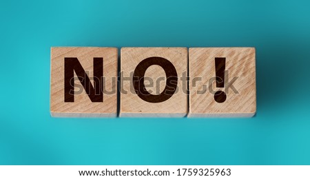 Wooden cubes with text no on a blue background. Negative answer concept. No risk, no violence or no discrimination concept. #1759325963