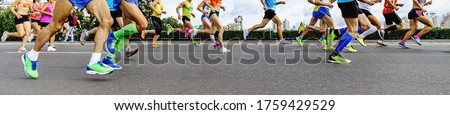 group athletes runners: men and women running city marathon in background of buildings Royalty-Free Stock Photo #1759429529