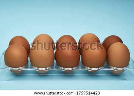 Chicken eggs in an egg holder. Full tray of eggs. Half an egg, egg yolk, shell. Food, protein in foods #1759514423