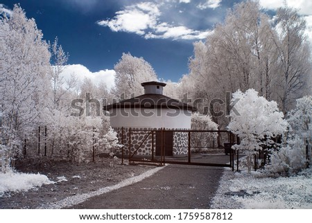 Infrared photography. Surreal landscape, building, beautiful trees with white foliage. Our beautiful world is in the spectrum of an infrared camera, which we do not see with the ordinary eye.