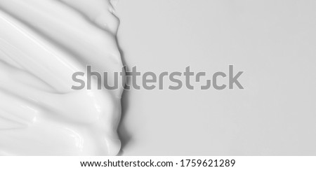 Close-up cream moisturiser smear smudge wavy texture on white background with copy space horizontal banner format. Skin care beauty product #1759621289