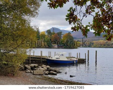 Paddle boats at the lake shore. Derwent Water, Keswick, Lake District, Cumbria, U.K. #1759627085