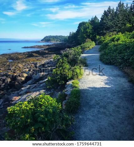 Afternoon walk down Bar Harbor Shore Path Royalty-Free Stock Photo #1759644731