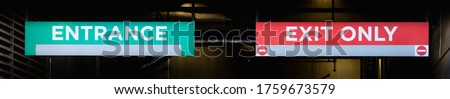 green entrance and red exit signs banner