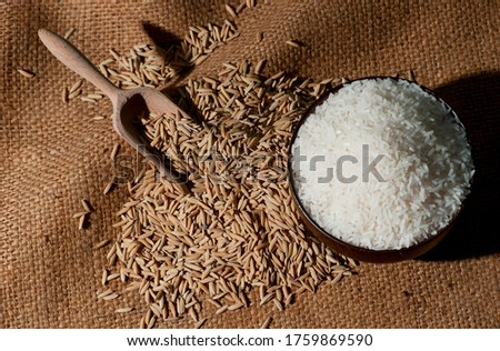 Rice is a cereal grass. With flowers and rows of rice grains There is a brown shell covering the inside of the rice kernel which has been peeled and cooked by boiling or steaming. To eat as food #1759869590