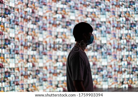 The young man wear masks stood to prepare for the event of the large LED screen, which was projecting a large number of attendees through conference program. selective focus Royalty-Free Stock Photo #1759903394