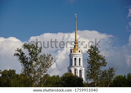 The domes are gold and silver with Orthodox crosses against a blue sky on a bright day, close-up. Old traditional architecture of Russia #1759951040