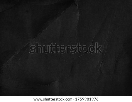 Old black paper texture background. Fold page. Grunge  Royalty-Free Stock Photo #1759981976
