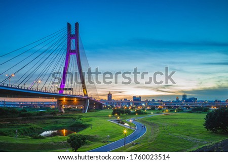 """New Taipei Metropolitan Park (Erchong Floodway Riverside Park). the translation of the chinese text is """"new taipei city bridge"""" Royalty-Free Stock Photo #1760023514"""