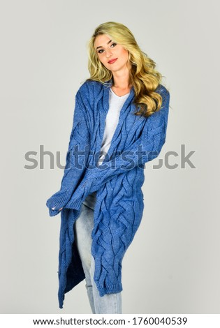 Cozy outfit. Woman wear knitted cardigan. Soft and comfy. Oversize cardigan for your comfort. Fashionable cardigan. Clothes shop. Girl long curly hair stylish outfit with soft wool cashmere cardigan. #1760040539