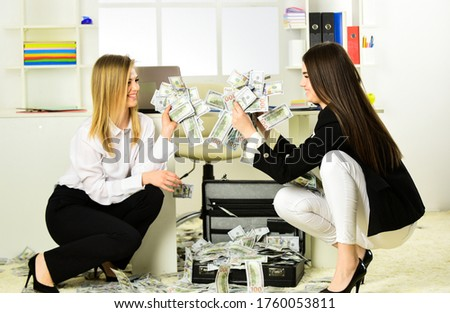 dirty money. women has business success. successful businessladies with case. Internet earnings of fake money. bribe and money laundering. dollar currency cash. Wealth and rich. #1760053811