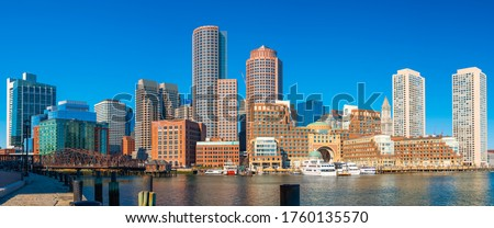 Panoramic Boston City Skyline and Seascape at the Boston Harbor. Clear Blue Sky Backgrounds.
