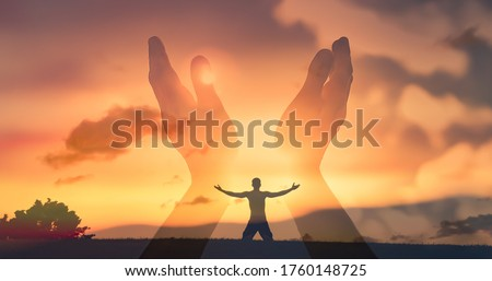 Worshiping hands raised up with open palms to the sunset sky.  Christian Religion concept background. Faith, hope, and prayer concept.  Royalty-Free Stock Photo #1760148725