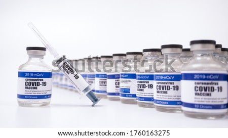 2019-ncov Covid-19 Corona Virus drug vaccine vials medicine bottles syringe injection. SARS-CoV-2 Vaccination, immunization, treatment to cure Covid 19 Corona Virus infection. Medical concept. #1760163275
