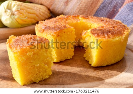 The sliced corn cake on a wooden board and a rustic fabric at the background #1760211476