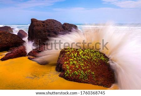 Splashes of waves on coastal rocks. Breaking waves rocks. Waves crashing on rocks #1760368745