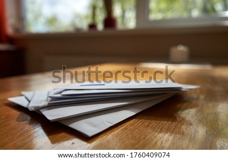 Bunch of envelopes in the kitchen Royalty-Free Stock Photo #1760409074