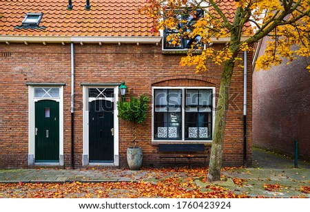 Autumn in city scene. City house in autumn #1760423924