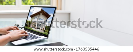 Looking Real Estate Property Online. Home Photos